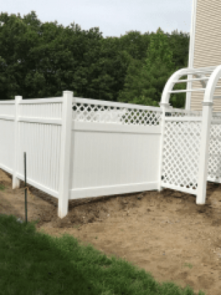 A white fence with an awning after a fence installation project in Hillside, NJ