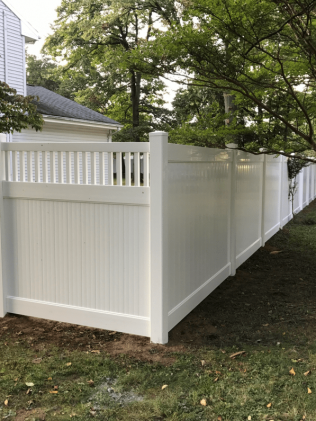 A white fence surrounding a Hillside, NJ property