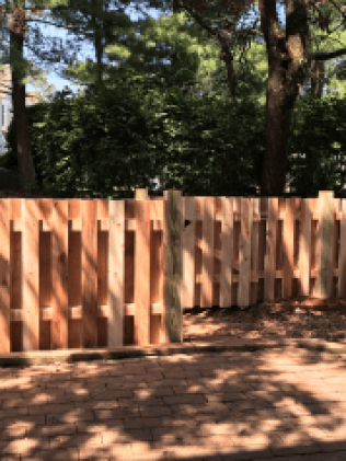 a wooden fence after fence repair services in Hillside, NJ